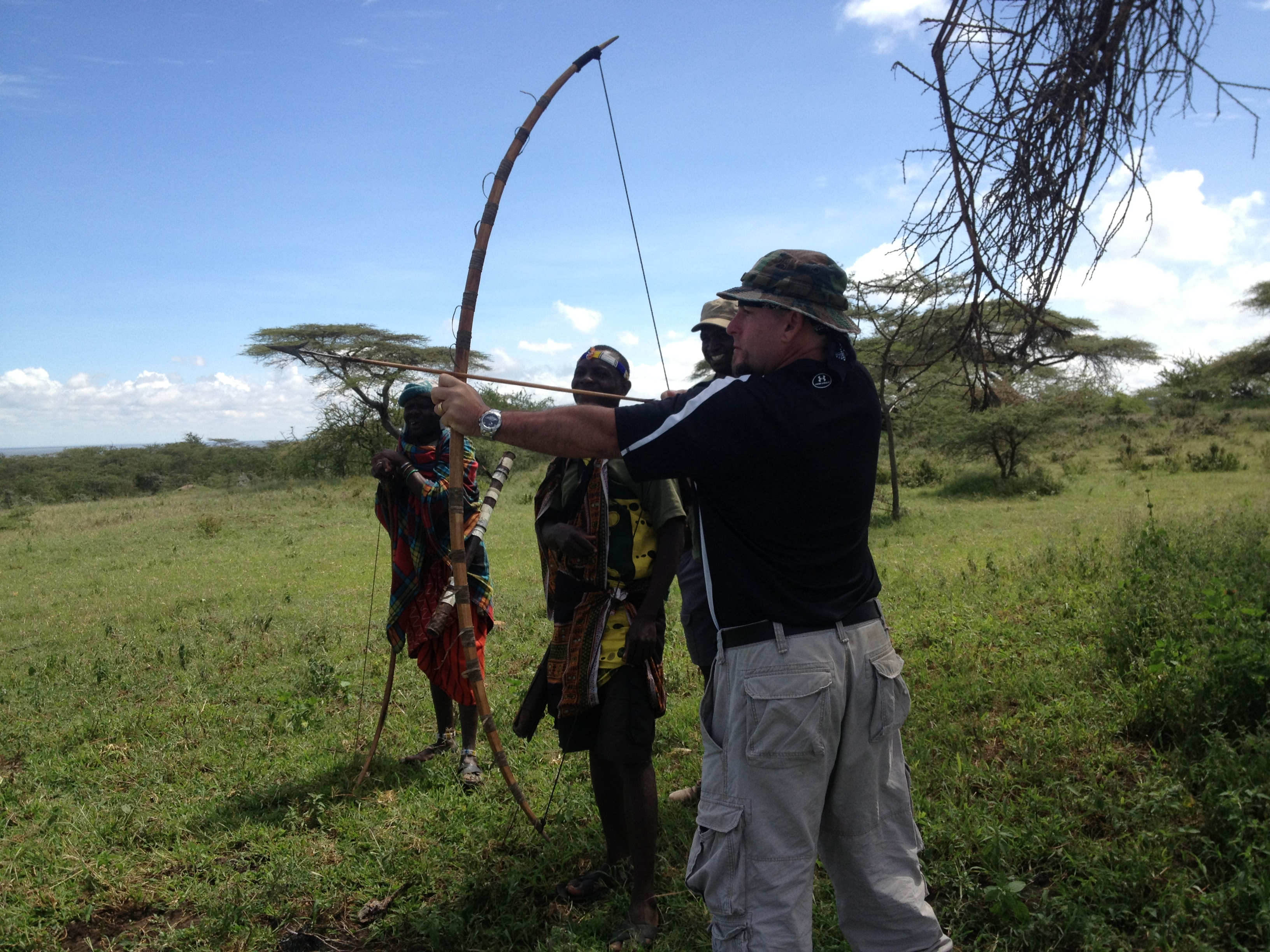Michael trying Massai bow & arrow