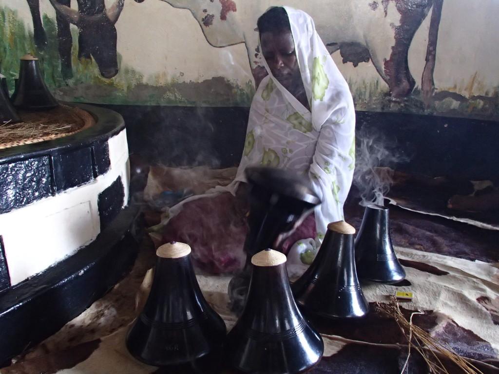 Cleaning Uganda milk pots