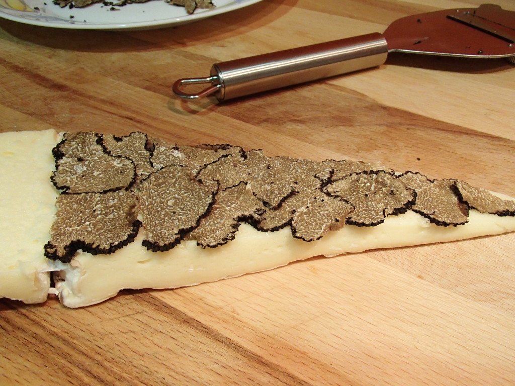 place truffle slices between two halves of brie